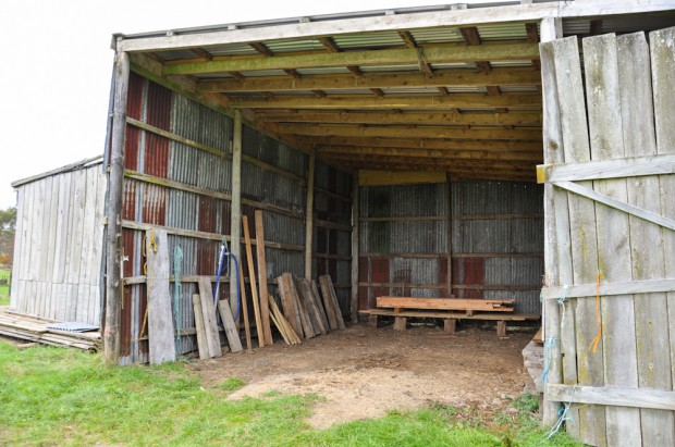 The barn with a handy selection of milled wood, old and new; sleepers, framing, beams, and slabs.