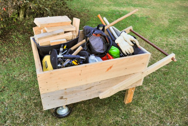 Putting wheelbarrows to shame: A bucket full of firewood, a tool bag, camera bag, boots and safety gear, petrol canister, chain lube, splitting maul, and there's even a large chainsaw buried among other bits and bobs.